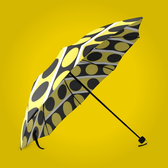 Fashionable umbrella rain accessory featuring black, white and yellow stripes and polka dots